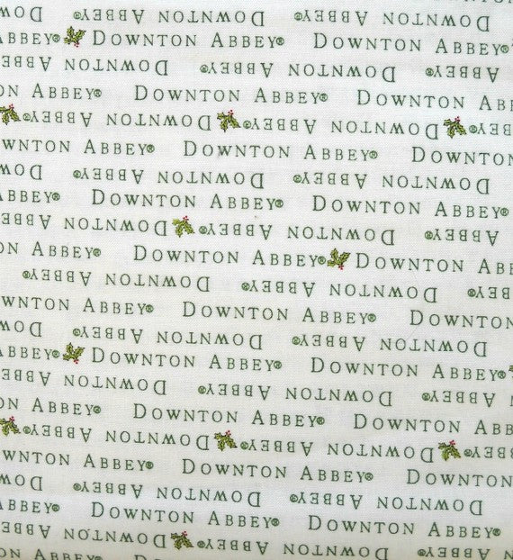 Downton Abbey Christmas Holiday Cotton Fabric With Green Words On Cream Background