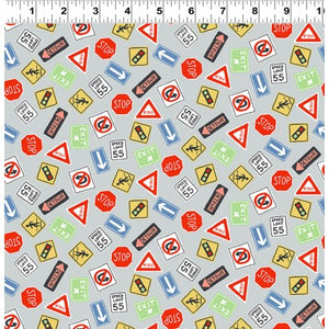 Keep On Truck'n Childrens Fabric Yardage Gray background with signs in red blue orange yellow green black