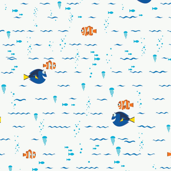 Finding Dory Disney cotton children's fabric.  Swimming fish in colors of blue orange and white