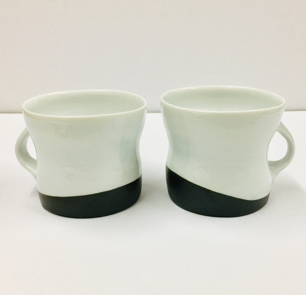 Elisa Helland-Hansen, Pair of Black and White Cups