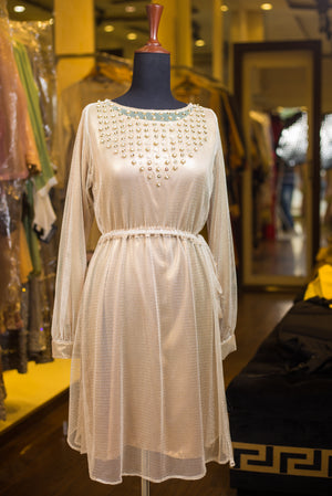 Net tunic with bedazzled neckline.