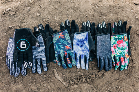 Gripit gloves laid out in a line on mountain bike trail in Midway, Utah.