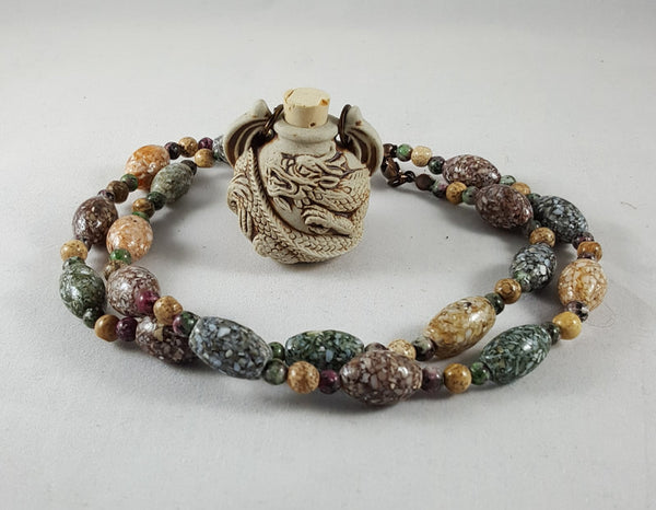 Ceramic Peruvian Bottle Necklace (Dragon, Ganesh, Raven, or Ohm)