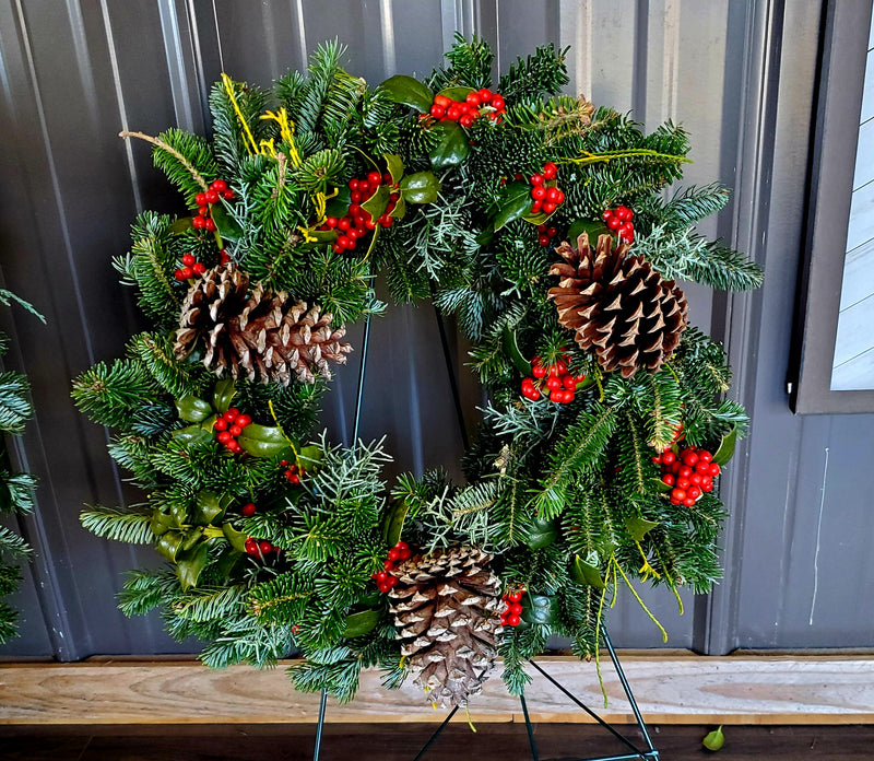 12-in deluxe fresh greenery wreath a Christmas holiday decoration