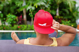 Red unisex trucker hat | Costa rica surf hotel | Surf hotel shop | The Gilded Iguana online store | Nosara gear