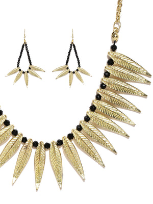 Gold toned leaf choker necklace with earrings