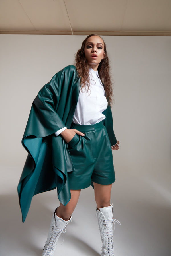 leather shorts in bottle green with leather poncho