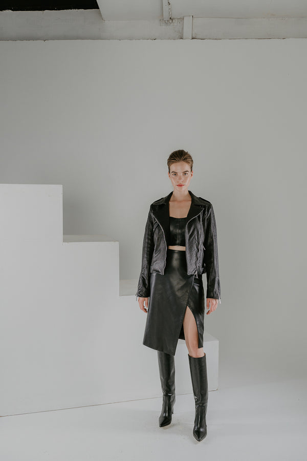 Edge wrap black leather skirt with a slit