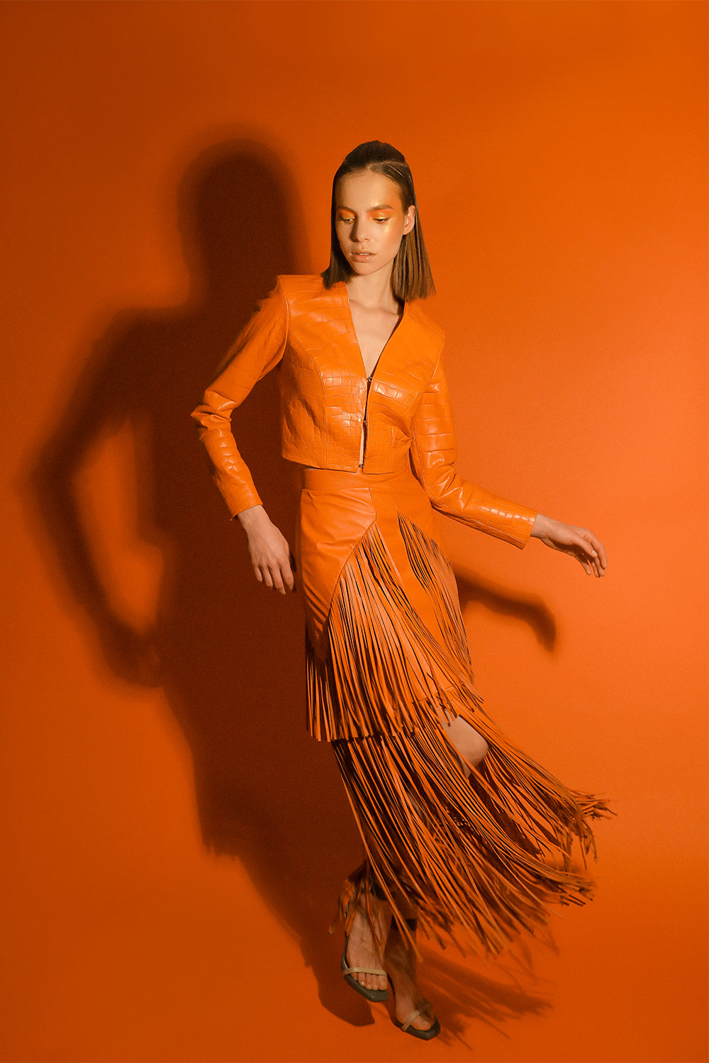 Hogon orange leather skirt with fringe