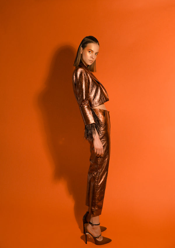 bronze cropped leather jacket and cigarette pants in bronze
