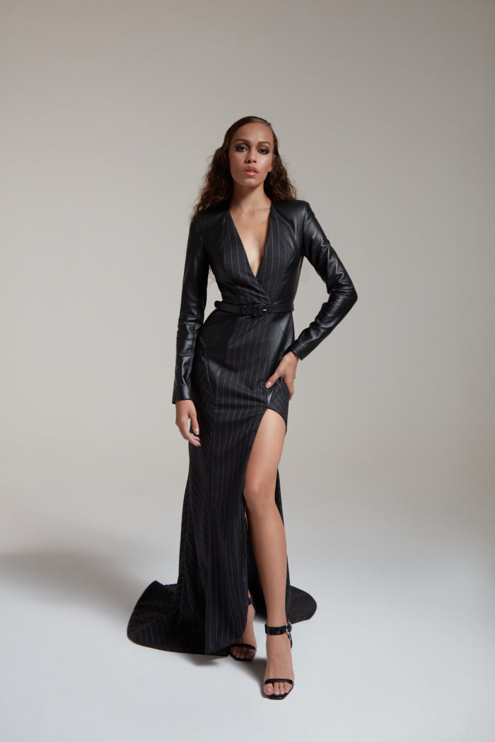Black fitted gown with a train in pin stripe wool and leather