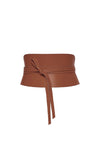 Leather corset belt in cognac brown tied with a knot
