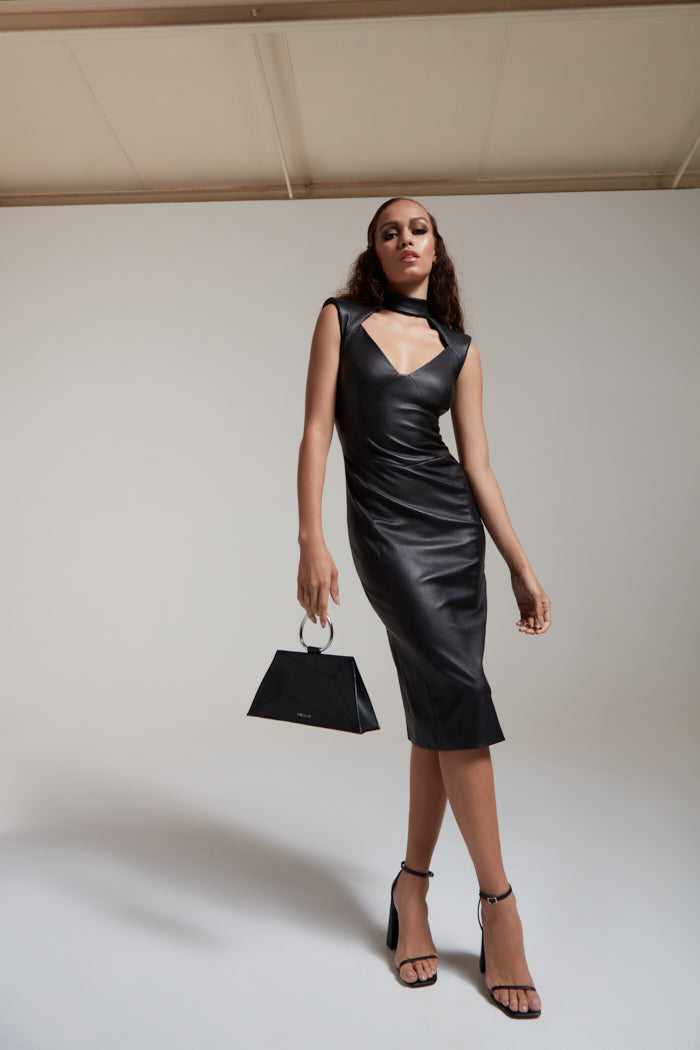 Body contouring stretch dress in black leather with cut out detail