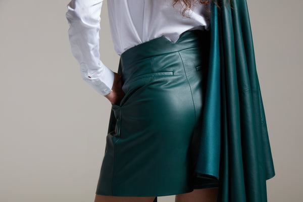 pleated leather shorts with back pockets in bottle green