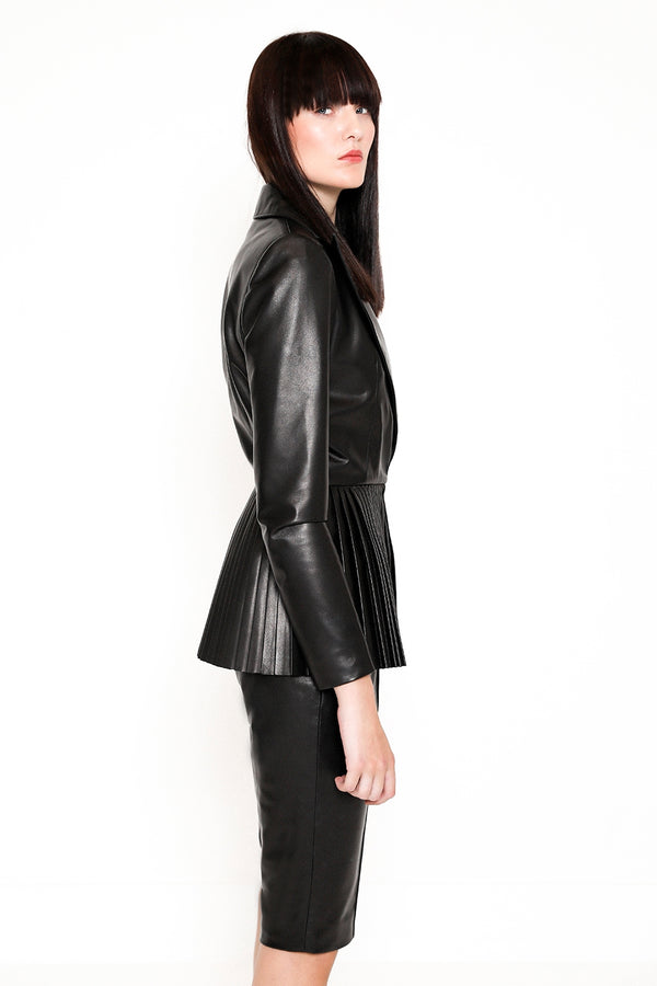 black leather shorts and pleated jacket