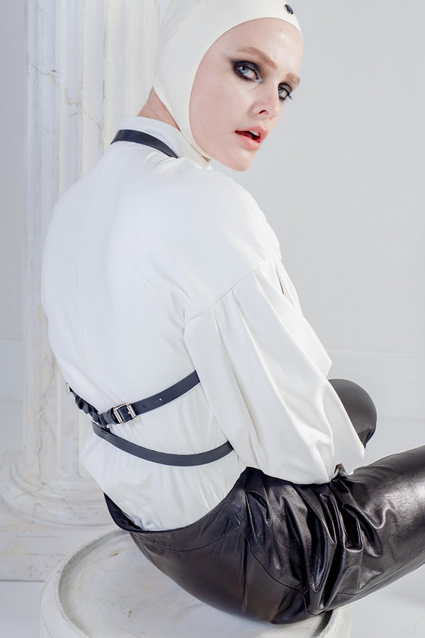 Black leather harness in white leather shirt