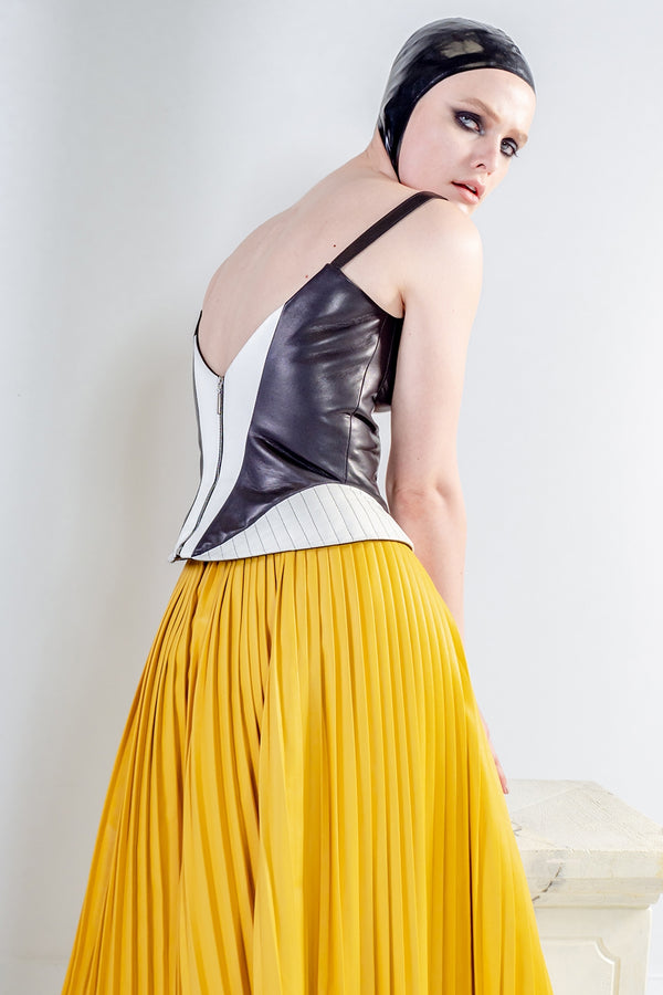 EOS pleated yellow skirt in leather