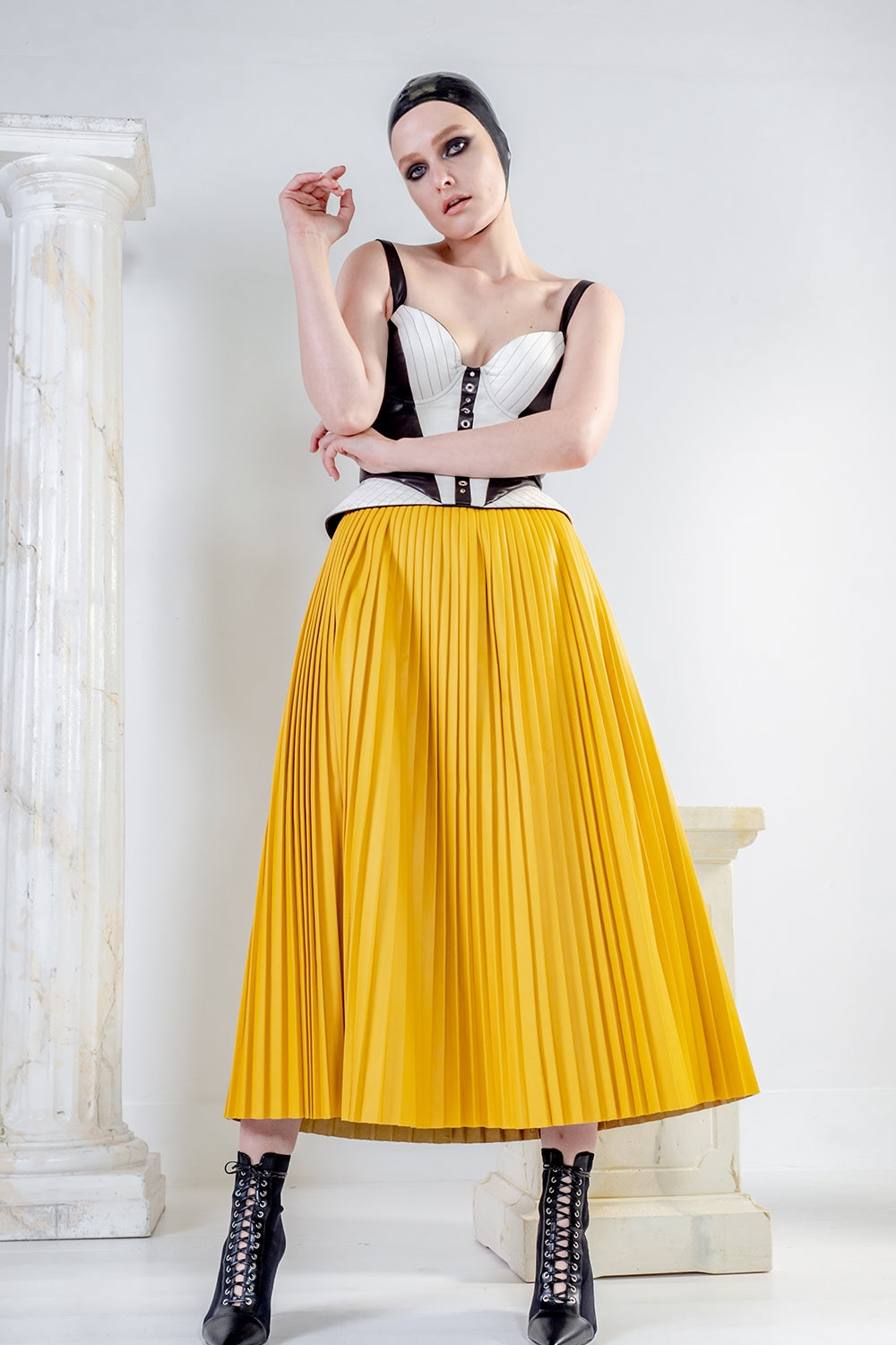 EOS leather pleated skirt in yellow ankle length