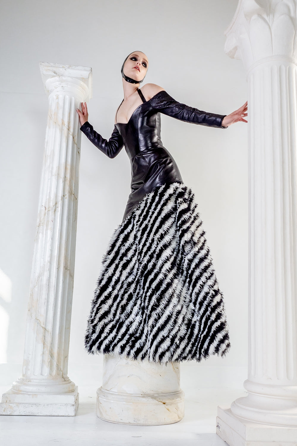 Lyssa couture leather dress with feathers and stretch python sleeves