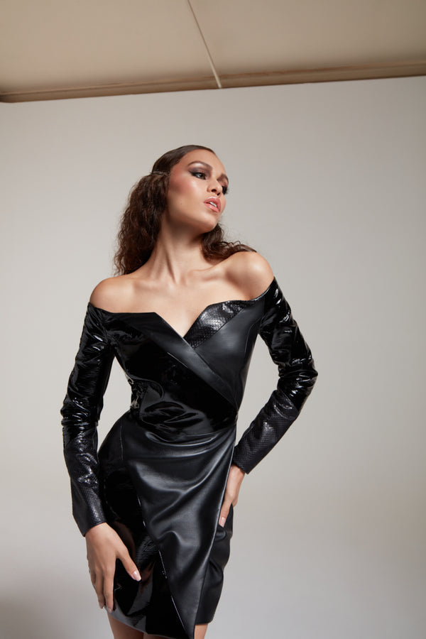 fitted leather dress with open chest and fitted sleeves