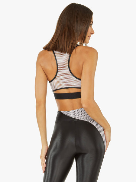 black full coverage sports bra with blush mesh back