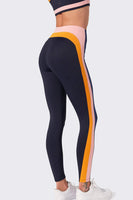black legging with multi color stripes down the side of the leg