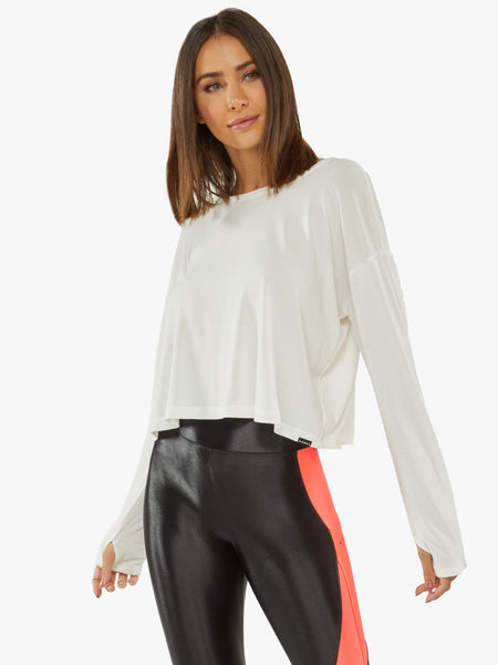 white long sleeve long crop with open slit in back