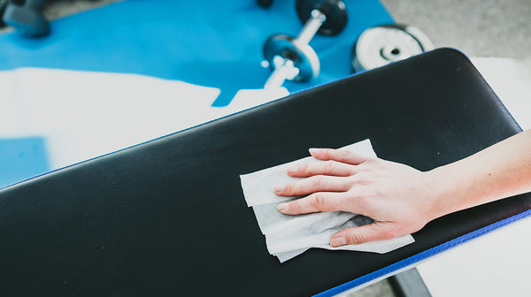 Antibacterial gym wipes cleaning bench