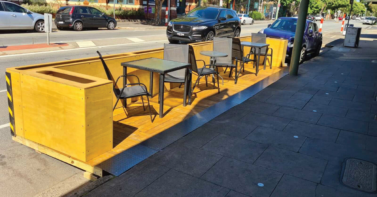 Create a parklet to increase your outdoor dining capacity and stay open this summer.