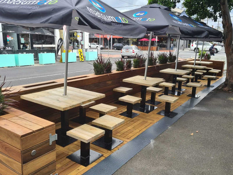 Fixed outdoor furniture on a parklet