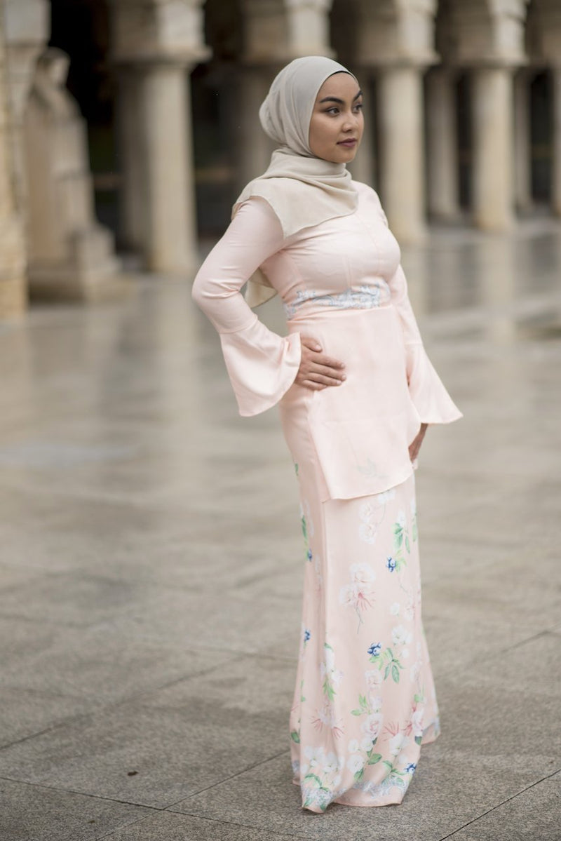 Fadya Peplum Dress in Pastel Peach