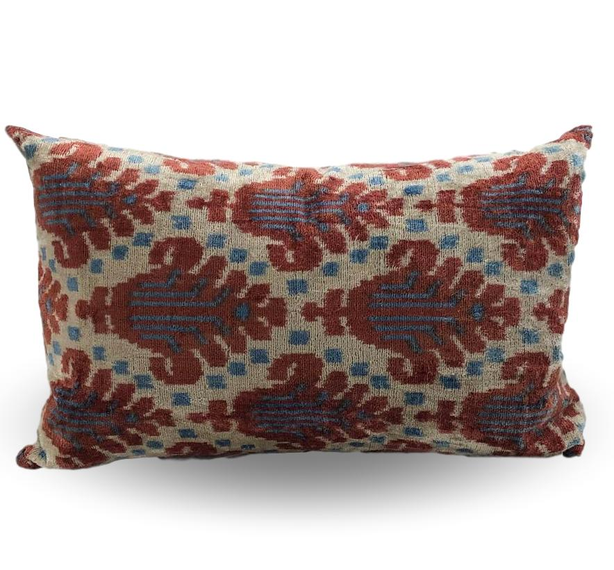 Salmon, Tan & Blue medallion-like pillow