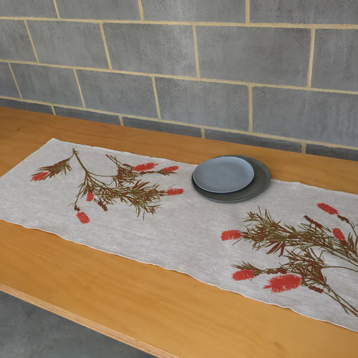 Photo of a Bottlebrush screen printed on a table runner.