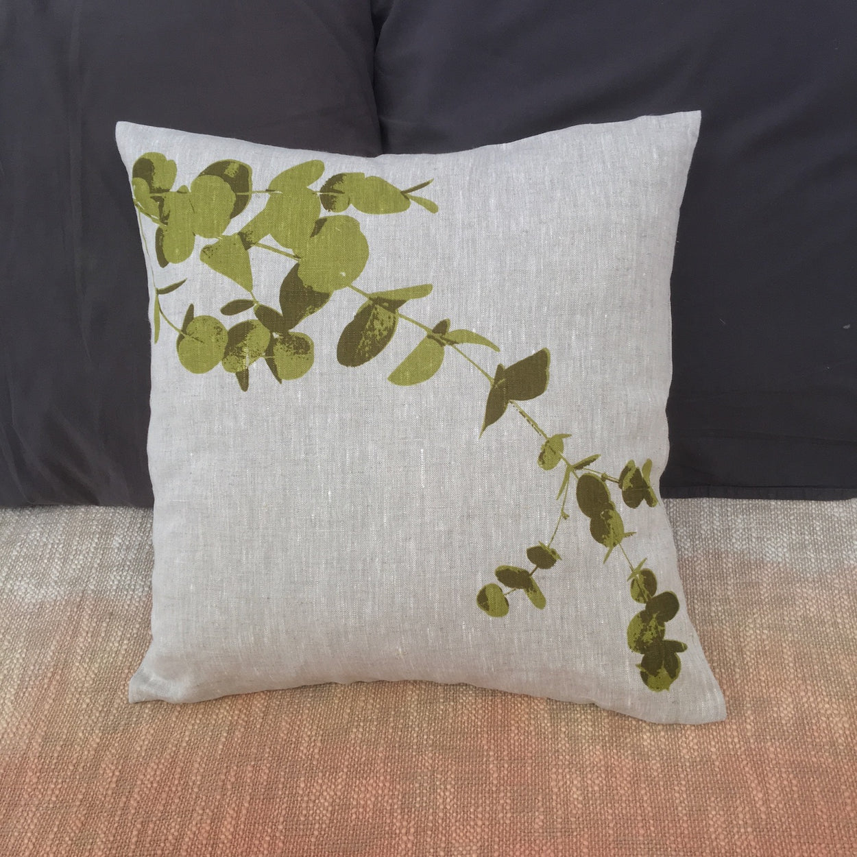 Photograph of eucalyptus leaves screenprinted on a cushion cover.