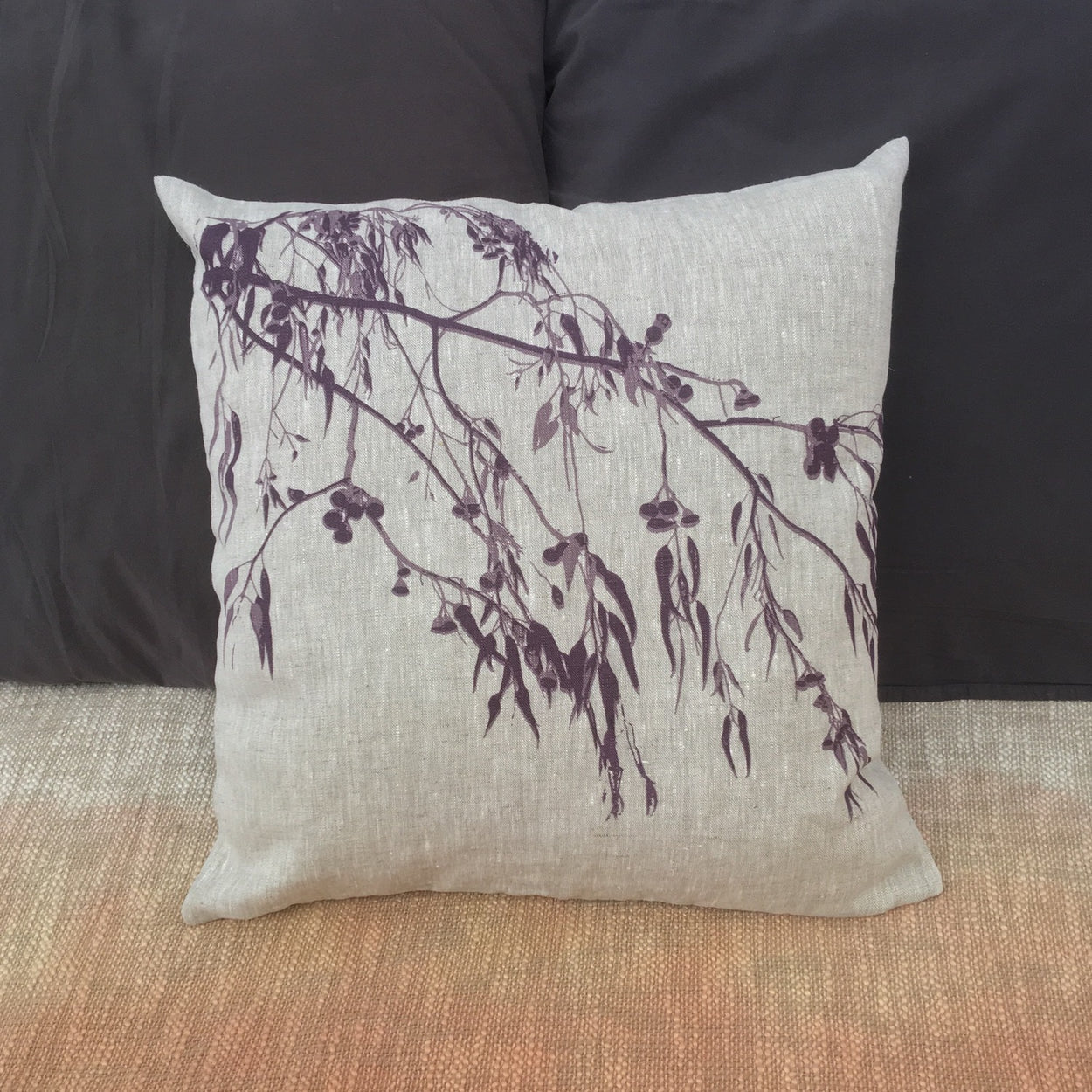 Photograph of a eucalyptus screenprinted on a cushion cover.