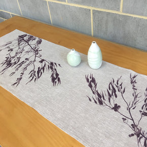 Photograph of a eucalyptus screenprinted on a table runner.