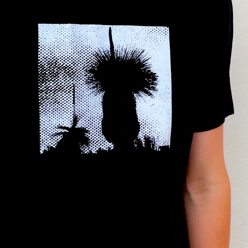 Photograph of screenprinted t-shirt depicting a Western Australian grass tree.