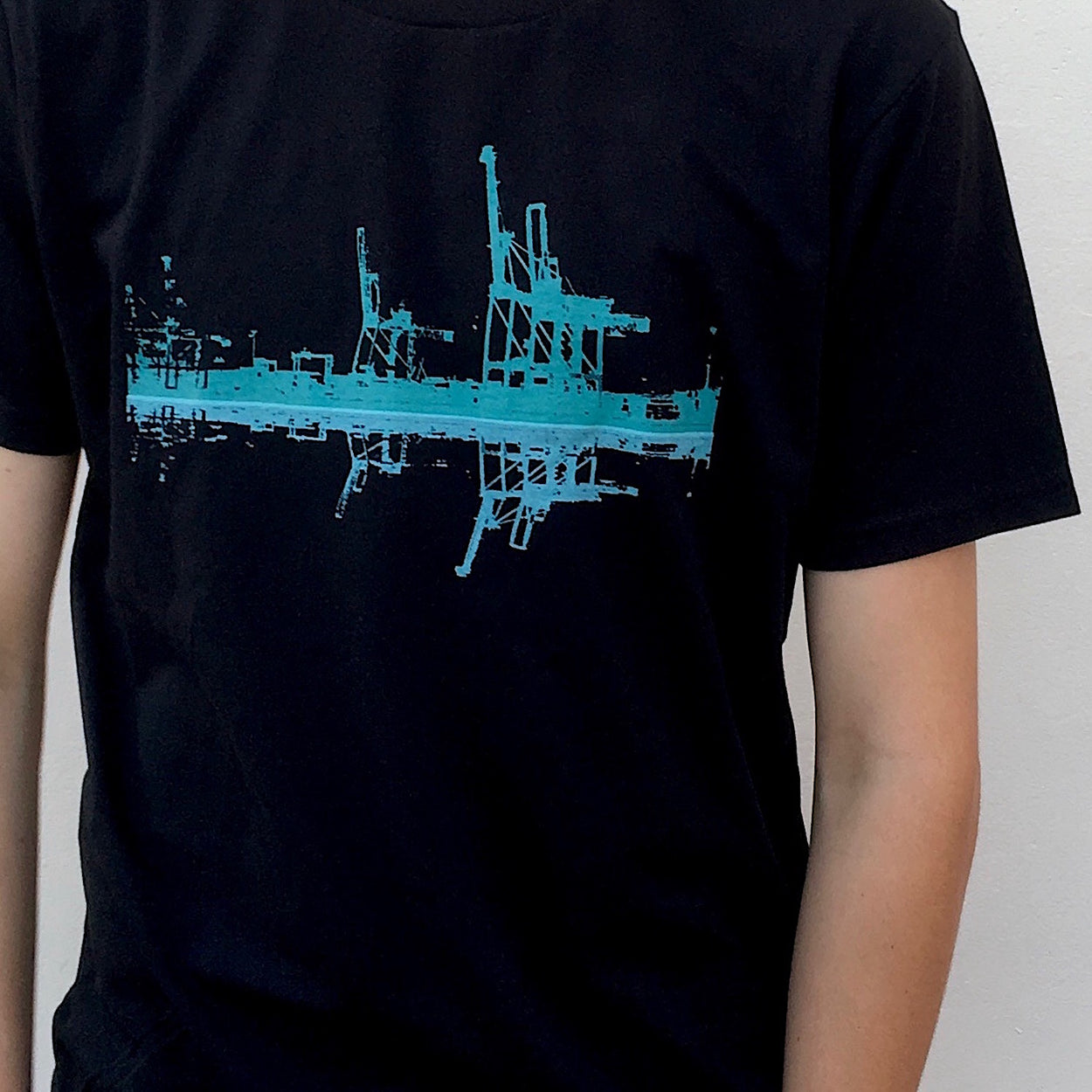 Photograph of screenprinted t-shirt depicting the container cranes at Fremantle Harbour.