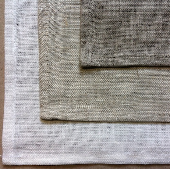 Photograph of linen in three different background colours.