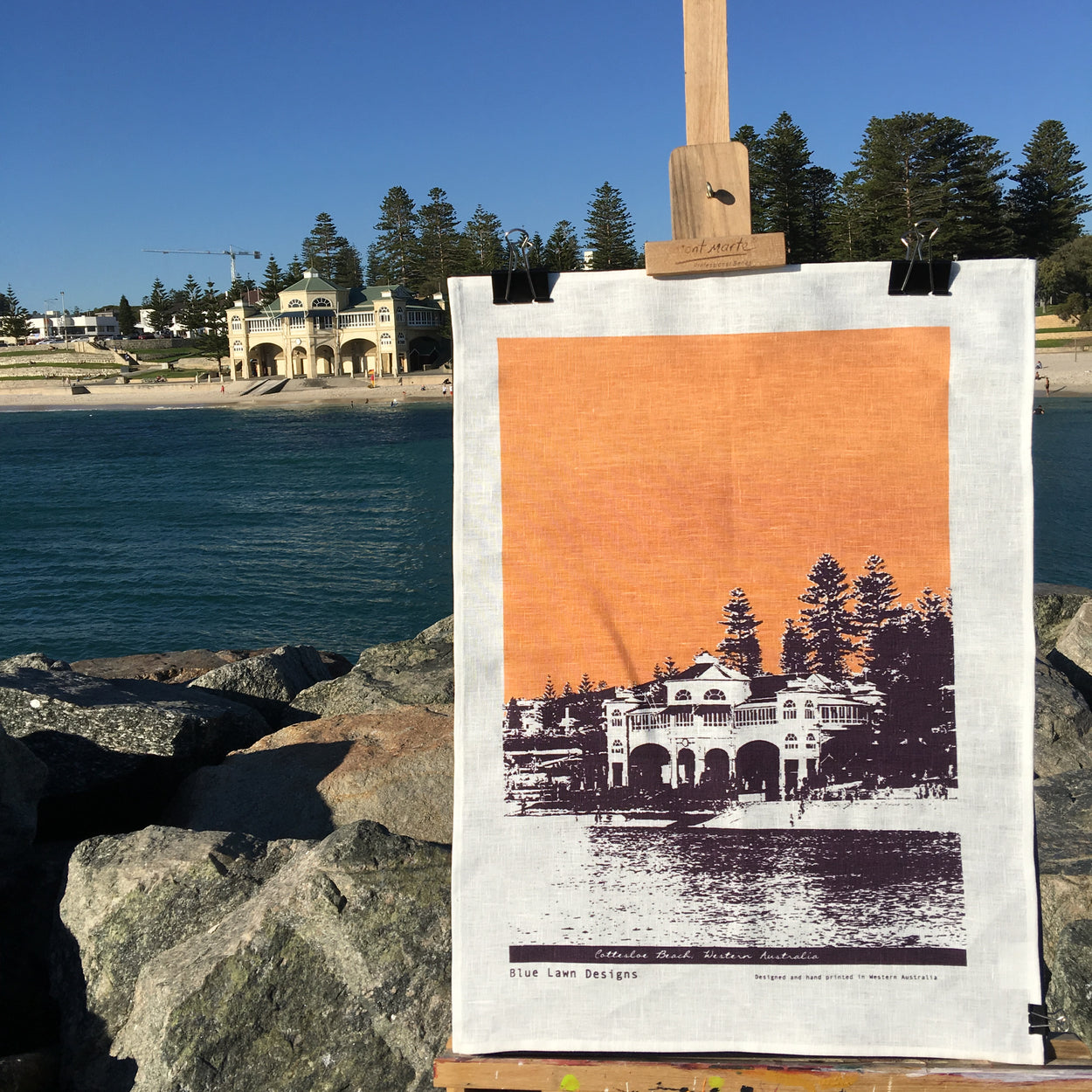 Photograph of a Cottesloe Beach tea towel on an easel.
