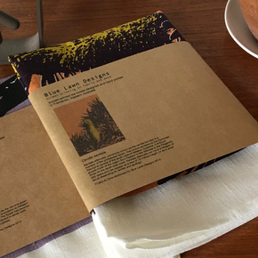 Photograph of tea towels packaged.