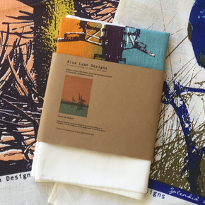 Photograph of screenprinted tea towels packaged.