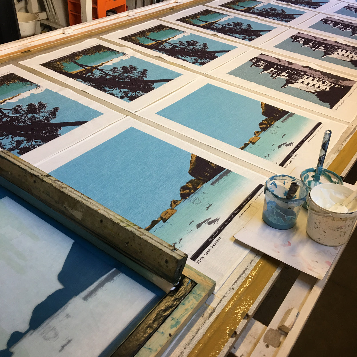 Photograph of tea towels being screenprinted.
