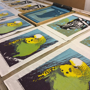 Photograph of native bird tea towels being printed.