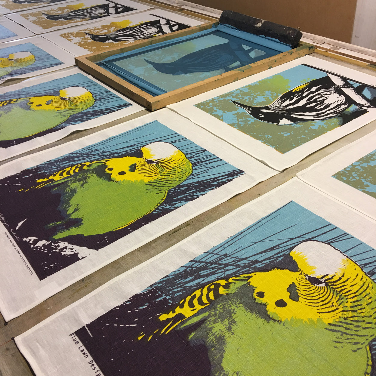 Photograph of native birds tea towels being printed.