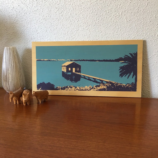 Photo of a blue boathouse on Perth's Swan River, screenprinted on plywood.