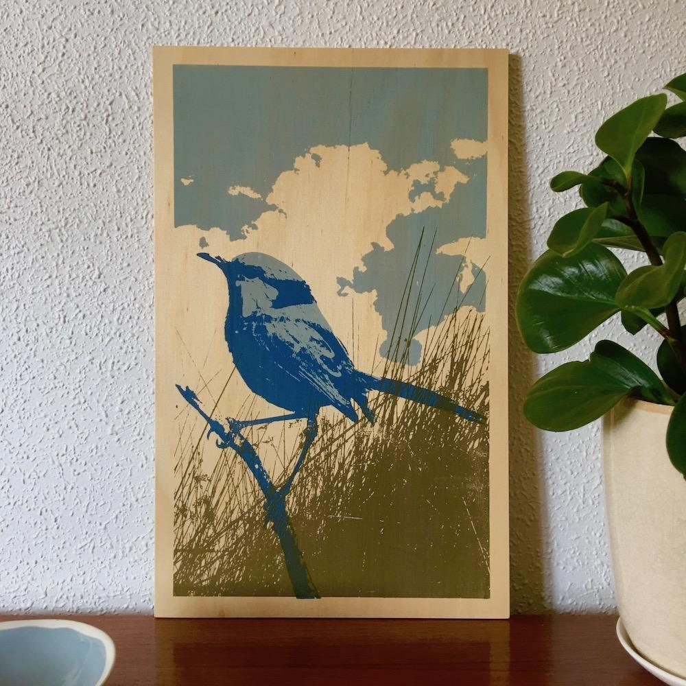 Photo of a splendid blue fairywren screenprinted on plywood.