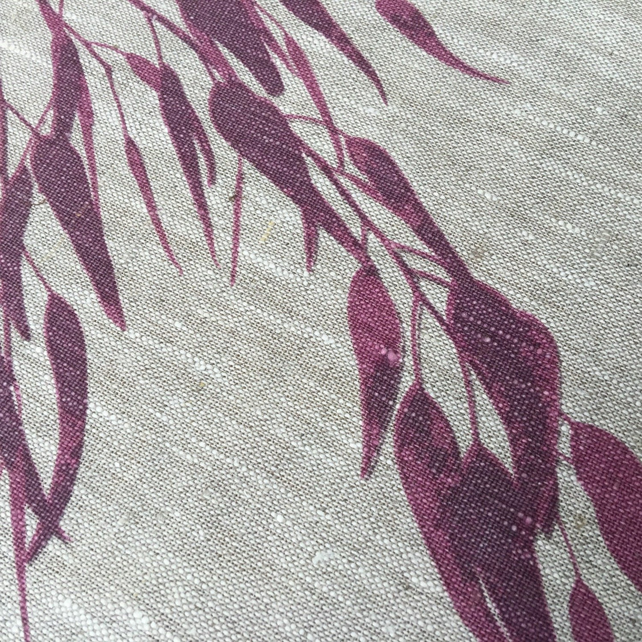 Photo of a Eucalyptus screenprinted on placemats, close-up.