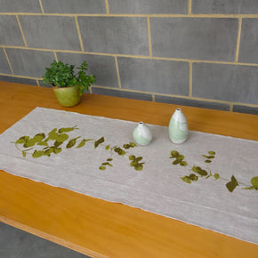 Photograph of gum leaves screenprinted on a table runner.
