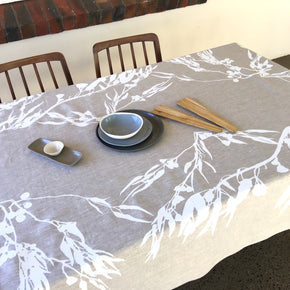 Photo of screenprinted tablecloth depicting eucalyptus flowers and leaves.